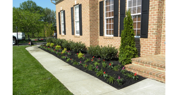 Installing a Sidewalk or Patio That Obscures the Sloping of Land Near the House